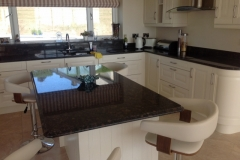Tan Brown Granite Worktop with Ogee Edge on Island & Recessed Draining Board